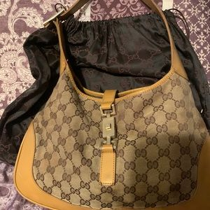 Gucci Authentic Jackie O Hobo pocket book .